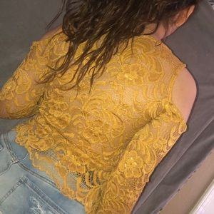 A laced high quality long sleeved yellowish shirt